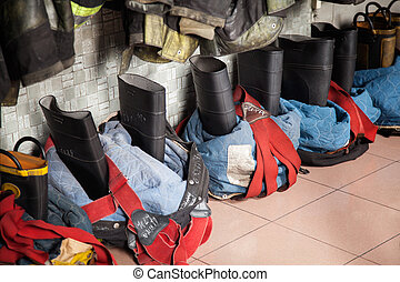 Firefighter's Boots On Floor At Fire Station