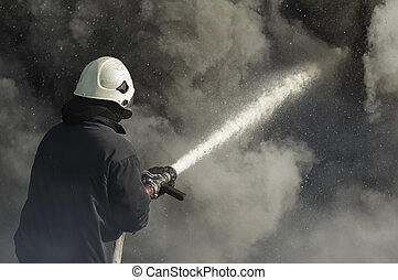 Firefighters extinguish a fire in a burning house