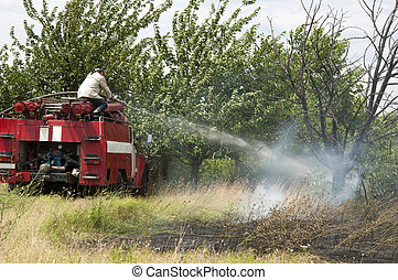 Firefighters extinguish a fire