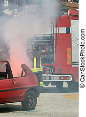 firefighters in action during a car accident