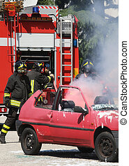 firefighters in action during a road accident