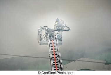 Firefighters in action fighting, extinguishing fire, in smoke.