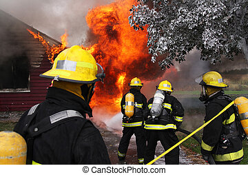 Firefighters in action - Firefighter at work on an abandoned...