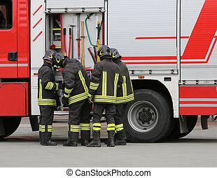 firefighters near the fire truck