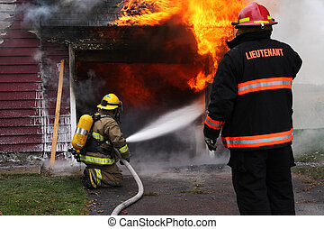 Firefighters on duty - Abandoned house in flame with...