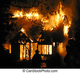 Firefighters pour water on a blazing house fire in Edmonton, Alberta, Canada.