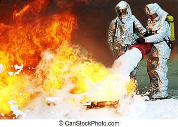 firefighters in protective suits extinguish a big fire