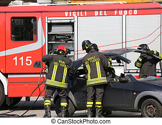 Firefighters take off the hood of the car after a car accident