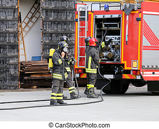 firefighters with breathing apparatus