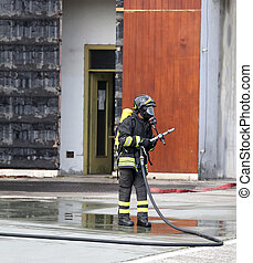 firefighters with breathing apparatus and oxygen bottles