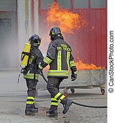 firefighters with oxygen bottles off the fire