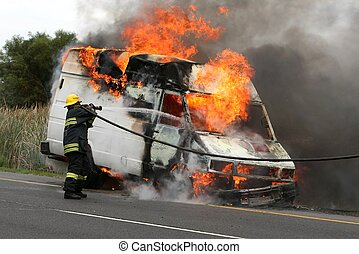 Firefighting and Burning Vehicle - Fireman spraying water...