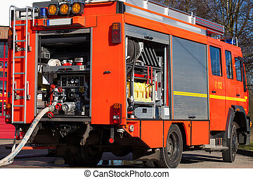 Firefighting vehicle with hose