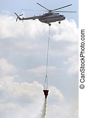 Fireguard helicopter - Fire helicopter releasing water from...
