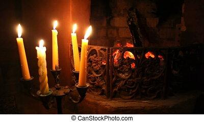 Fireless fireplace with candles nea