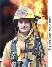 A young fireman in uniform