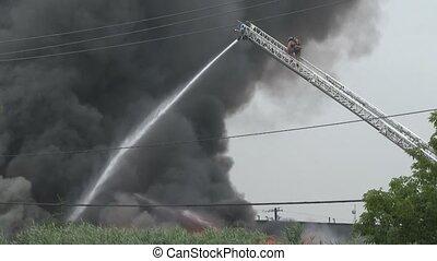Fireman climbing with black smoke