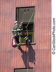 fireman during a fire drill whitel climbs on the house