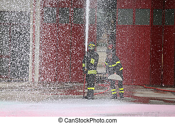 fireman during the fire drill with the hose