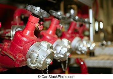 fire truck hose faucets in a row - Fireman fire truck hose...
