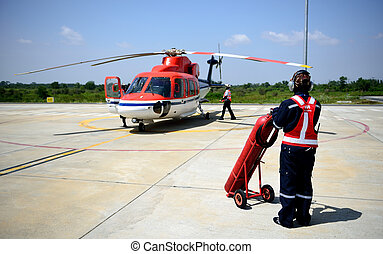 fireman is guarding for helicopter before start up engine.