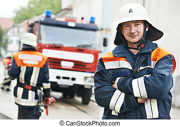 Fireman portrait at training - Fireman in uniform in front...