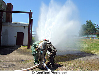 Fireman spraying water