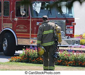 Fireman - Tired fireman walking back to the fire truck