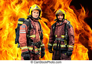 Firemen against burning background. - Conceptual portrait of...