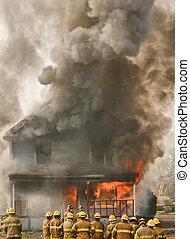 Firemen at a burning house