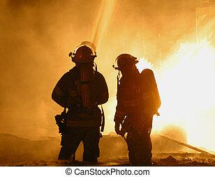 firemen at blaze - two firefighters at blaze