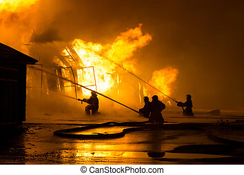 Firemen at work on fire