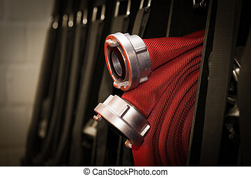 Firemen hose coiled with connection