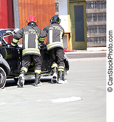 firemen in action during the car accident