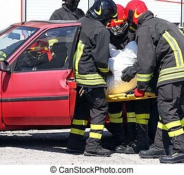 firemen pull the injured from the car after the car accident