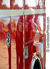 Firemen reflection in a firetruck