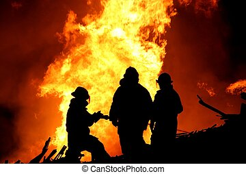 Firemen Silhouette - Silhouette of three firemen fighting a...