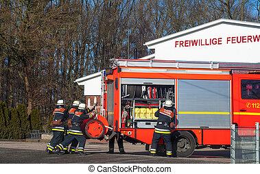 Firemen with emergency vehicle