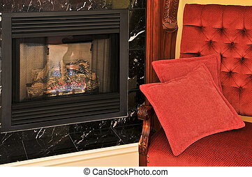 Fireplace and red chair