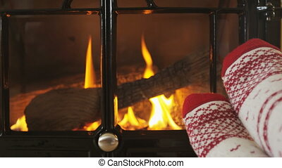Fireplace and Woman Feet In Socks Against Fire Getting Warm ...