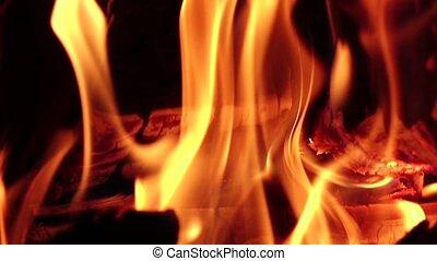 Fireplace burning. Warm cozy fire in fireplace, closeup....
