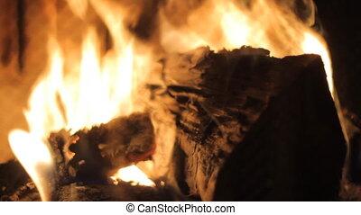 Fireplace - Burning wood in stone fireplace