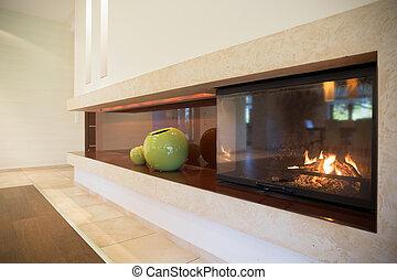 Fireplace inside modern interior - Horizontal view of...