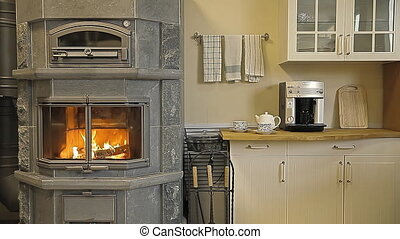 Fireplace-stove in the kitchen - Kitchen. Firewood is lying...