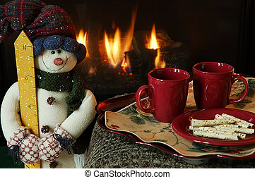 Cookies and hot drinks by the fire on a chilly winter day.