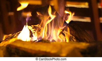 Burning in the fireplace in the comfort cozy cafe. -...