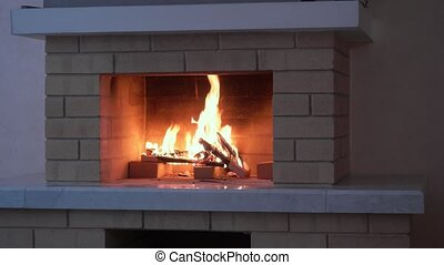 Fireplace with medium size flames. Relaxing view on fire.