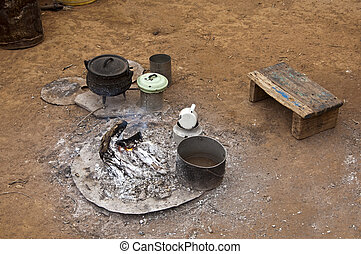 Fireplace with pots and other kitchen ware in a camp site of local Nama herders near Kuboes, Richtersveld, Northern Cape province, South Africa