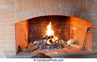 fireplace with warm fire on the background
