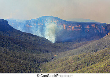 Fires burning in Grose Valley Blue Mountains - A bushfire...